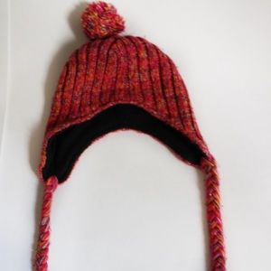 Pink knitted beanie with pom-poms